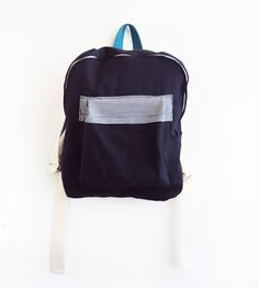 Navy backpack with stripes