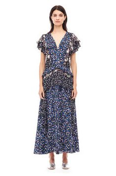 Patched Print Dress This vintage-inspired style gets a bold update in a mashup of printed silks, finished with soft ruffles at the sleeves and waist. Drop waist. Flutter sleeves.