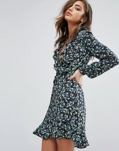 Pretty floral ruffle wrap dress paired with chunky boots for stylish winter outfit