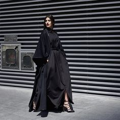 """Bouguessa Fall/Winter 2015-16 Campaign. Wool Felt Poncho Abaya worn on top of Oversized Black Shirt Dress #BouguessaFW15 #Bouguessa #DIFC #ddfc #d3…"""