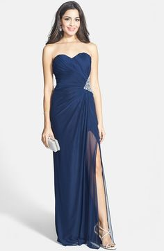 Free shipping and returns on Xscape Side Cutout Embellished Strapless Gown at Nordstrom.com. A wedge of sparkling crystals carves a curvaceous silhouette at the side of a vibrant power-mesh gown designed with a sweetheart-neckline bodice lavishly pleated for flattering dimension. Side cutouts create a series of striking straps across the back before the gown drapes gracefully to floor-sweeping length.