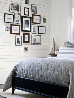 create wall collage using quotes, pictures and framed fabric.