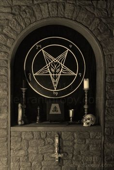 Satanic altar, featuring the Sigil of Baphomet altarpiece handcrafted by Reverend Byrd.
