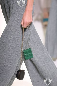 """Micro Bags Are Trending in a Macro Way (Yes, Still) Not all street style trends are the easiest to wear IRL. But micro bags, the """"It"""" accessory amongst the latest crop of New York and London Fashion Week showgoers, most certainly are (which is part of why they've stuck around for, oh, four-plus seasons now).<br> Micro bags were the It accessory amongst the latest crop of New York Fashion Week showgoers. Shop our favorites here. Balenciaga Handbags, Burberry Handbags, Hermes Handbags, Tote Handbags, Crossbody Bags, Women Accessories, Fashion Accessories, Fashion Jewelry, Womens Designer Bags"""