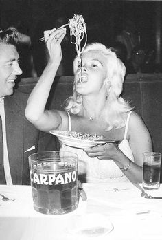 Jayne Mansfield and husband Mickey Hargitay eating spaghetti in Rome ~ 1961