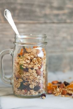 A healthy recipe for Almond Coconut Granola using coconut oil, lots of heart healthy almonds and chopped dried cranberries, cherries and apricots.