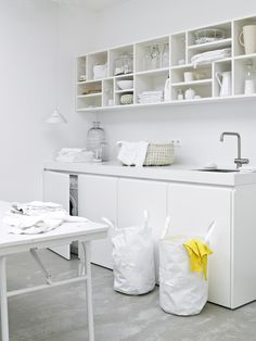 Cupboards to hide washing machine & love the all white