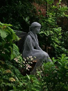 Chicken wire sculpture in a garden by Derek Kinzett, Titania from MidSummer's Night Dream.