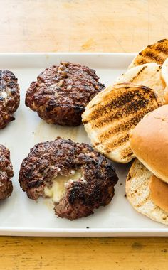"""Jucy Lucy Burgers: This famous Minneapolis dish really puts the cheese in cheeseburger. We perfected our technique for the """"Jucy Lucy"""" burger, stuffed with American cheese, to make sure you get a juicy burger and gooey, melted cheese. American Test Kitchen, Beef Recipes, Cooking Recipes, Hamburger Recipes, Cooks Country Recipes, Recipe Filing, Dinner Entrees, American Cheese, Food And Drink"""