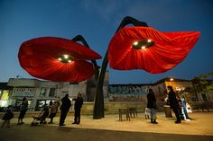 Giant Urban Flowers bloom when people walk underneath them.  http://www.mymodernmet.com/profiles/blogs/hq-architects-warde
