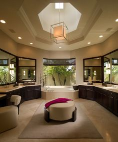Ah! Love the curved walls and the mirrors with the tub at the end. Add an awesome shower and this is the perfect master bathroom!