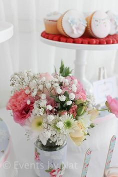 Bouquets at the tables! Baby Breath! Hello, so cute.