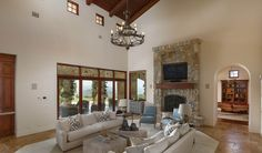 Embracing its rustic splendor, soaring ceilings, expansive windows and sliding doors, and a warm color palate comprised of rich wood and natural finishes add to the home's inviting ambiance.