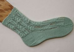 Knit Sock Pattern: Feathered Cable Socks Knitting Pattern.