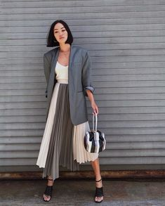 Mar 2020 - They're two wardrobe staples that, when worn together, will unlock a whole host of chic looks. Here are the best blazer and skirt outfit ideas to try. Best Blazer, Look Blazer, Pleated Skirt Outfit, Skirt Outfits, Midi Skirt, Pleated Skirts, Long Skirts, Dress, Who What Wear