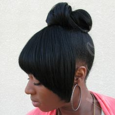 Extensions added to create a high-up ponytail and bangs.