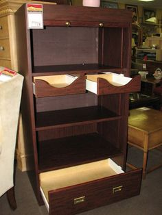 Storage cabinet with tambour door, three drawers, and an adjustable shelf $270. Available in-store