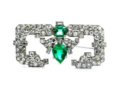 Diamond and emerald brooch by Cartier