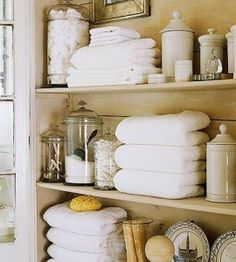 Keep it pretty!! If you have bathroom items {q-tips, towels, hair ties, bobby pins, exd} make it pretty. Use pretty storage containers, mix in some decor items, hide those towels that aren't so pretty, & by doing this the bathroom can be pretty & de-cluttered all at the same time.