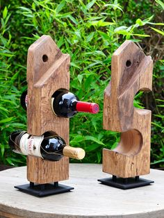 Reclaimed Wood Wine Stand Made out of weathered reclaimed oak barn joist (with original tenon and peg hole) and black painted steel plate with rubber feet. Wood has got a nice warm colour with lots of saw lines, cracks, marks and woodworm holes. It has been hand clean and treated with