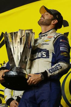 Jimmie Johnson Photos Photos - Jimmie Johnson, driver of the #48 Lowe's Chevrolet, celebrates with the NASCAR Sprint Cup Series Championship trophy in Victory Lane after winning the NASCAR Sprint Cup Series Ford EcoBoost 400 and the 2016 NASCAR Sprint Cup Series Championship at Homestead-Miami Speedway on November 20, 2016 in Homestead, Florida. Johnson wins a record-tying 7th NASCAR title. - NASCAR Sprint Cup Series Ford EcoBoost 400