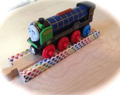 Washi tape on Brio wooden train tracks by woodpeckers. Woodpeckers, Wooden Train, Brio, Train Tracks, Washi Tape, Facebook, Toys, Green Woodpecker, Toy