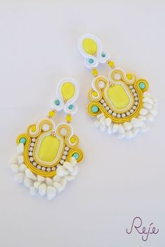 """Colorful Collection s/s 2015 -Reje- The best of Handmade in Italy Soutache earrings """"Yellow suggestion"""",entirely hand-sewn in gipsy-bohemian style, with purple tassels  Materials: soutache, cabochons, beads, Colors: Orange, dark yellow, light yellow, purple, turquoise  Reje's jewelry are finest jewelry, hand-sewn and finished with the utmost care Etsy shop: https://www.etsy.com/your/shops/Rejesoutache/tools/listings/230803513 www.rejesoutache.com…"""