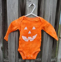 Orange pumpkin jack-o-lantern bodysuits by peacebabybatiks on Etsy ... Available made to order in 3m, 6m, and 12m!