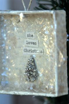 bethquinndesigns. Little box used as a hanging Christmas tree ornament with a little pewter charm inside.