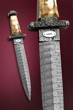 """Viking Dagger"" by Jim Schmidt and now in the collection of Dr. Larry Marton. Ladder pattern Damascus blade, forged of 203 and W2 steels. A magnificent small dagger is hidden in the fossil walrus ivory handle. Only one ever made. Overall length 15 3/4"""