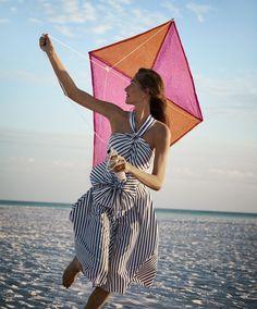 Flying a kite, Josephine le Tutour wears CH Carolina Herrera dress and Tacori earrings