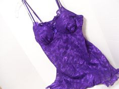 Seductive Wear by Cinema Gorgeous Royal Purple Spaghetti Adjustable Straps Padded bust enhancing bra top Empire Waistline Elastic back  MARKED A SIZE MEDIUM   PLEASE READ DETAILS AND MEASUREMENTS CAREFULLY. (DOUBLE CHECK THEM) CONTACT US WITH YOUR QUESTIONS/CONCERNS PRIOR TO PURCHASING. DONT HESITATE TO ASK FOR ANY ADDITIONAL MEASUREMENTS, ADDRESS FIGURE CONCERNS OR CLARIFICATION OF LISTING. I WOULD RATHER TAKE THE EXTRA TIME TO MAKE SURE YOU HAVE A GOOD FIT THAN TO HAVE A DISAPPOINTED…