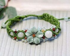 I love this bracelet where Jade flower beads have been woven into the handmade design