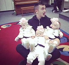 The baby on the right. Like HE'S HOLDING ME! Th baby in the middle OH YES the baby on left. OH YEAH and Tyler, THIS IS SICK AS FRICK!