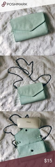 Light Blue Crossbody Worn but great condition - had many uses Some parts of the bag look faded in terms of texture, but barely noticeable Has many card holders, room for cash, and mobile phone Removable straps Kimchi Blue Bags Crossbody Bags