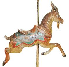 """CAROUSEL GOAT """"PTC #9."""" IN NATURALISTIC COLORS WITH A POLYCHROME SADDLE, CIRCA 1905.    Made by the Philadelphia Toboggan Company, which last operated in Pine Grove, Pennsylvania. The carousel was shipped back to the factory in 1925 for refurbishment; this figure retains the paint from that time period."""