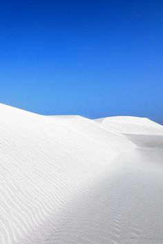 20 Travel Destinations You Won't Believe Actually Exist!  On the Socotra island of Yemen, you'll see some of the most AMAZING white sand dunes in the world.  If you get confused thinking it is snow, the temperature there will remind you its not (not that Yemen is a safe place for any traveler to visit now).