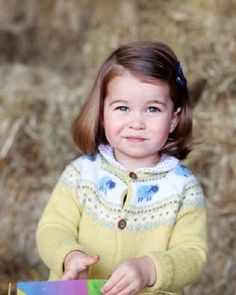 Princess Charlotte of Cambridge ahead of her 2nd birthday. It shows little Princess on the grounds of Anmer Hall, the family's country home, wearing a yellow cardigan sweater decorated with images of sheep.