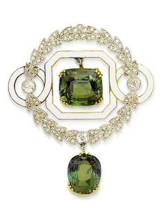 An early 20th century alexandrite, enamel and diamond brooch, circa 1905. Of circular form, the central cushion-shaped alexandrite drop within a triple four-claw setting, suspended from a white enamel octagonal frame with circular shoulders, encircled by an old brilliant and rose-cut diamond laurel-leaf wreath surround, terminating in a second cushion-shaped alexandrite drop within a triple three-claw setting, mounted in platinum and gold, length 4.5cm. #Edwardian #antique #brooch