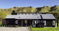 """There is something inherently sophisticated and unassuming about a black house. Yes, I did say """"unassuming"""" because a black house will always sit more quietly..."""