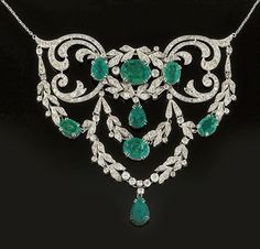 An early century diamond and emerald necklace. Of openwork scroll and foliate corsage design, the old brilliant-cut diamond swags with pear-shaped and oval emerald drops and accents, the mount circa the emeralds later added Emerald Necklace, Emerald Jewelry, Pendant Necklace, Sapphire Earrings, Emerald Rings, Ruby Rings, Wire Pendant, Emerald Diamond, Edwardian Jewelry