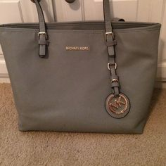 MAKE ME AN OFFER Gunmetal Michael Kors tote! Used once. Perfect for a beach day or a day in the city. Michael Kors Bags Totes