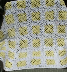 """Baby Blanket - """"Yellow on White Granny"""" This Granny Blanket was hand crocheted in Light Yellow on White. It measures 35 x 35 inches. Created in the USA and is completely machine washable. PH-1358 $65."""