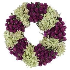 "Adorned with purple globe and green hydrangea, this charming wreath is a welcoming accent on an entryway wall or displayed above your mantel.  Product: Preserved wreathConstruction Material: Preserved and dried florals, silicone and natural twigsColor: Purple and greenFeatures: Includes preserved hydrangeas and caspiaHandmadeDimensions: 10"" Diameter  Note: Avoid sunlight and humidity"