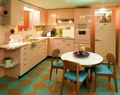 Love the linoleum floor and pink (metal?) cabinets and what I believe is a Haywood Wakefield kitchen table.