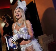 "Las Vegas book launch party for my 2nd travel guide ""Naughty Girl's Guide to Las Vegas.""  Having such a blast and so excited! Winner of best travel guide 2015.  #book #lasvegas #vegas #travel #showgirl #feathers #allwhite #sparkles #gloves #lingerie #bra #panties #boa #hat #necklace #armcandy"