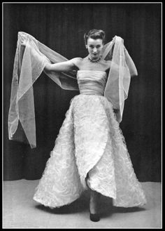 Model in evening gown of white bubbled tulle on silk faille, bodice is draped tulle, by Balenciaga, photo by Pottier, 1951