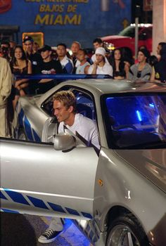 Still of Paul Walker and his car in 2 Fast 2 Furious! Paul Walker Auto, Paul Walker Tribute, Actor Paul Walker, Paul Walker Wallpaper, Furious Movie, The Furious, Movie Fast And Furious, Skyline Gtr R34, Nissan Skyline