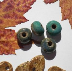 Four Turquoise and Teal Stoneware Rondelles