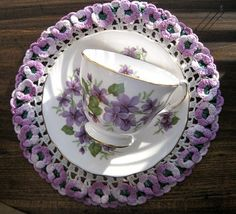 lilac teacup/saucer Wish someone would crochet me this doilly.